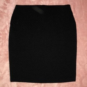 Black fitted mini skirt